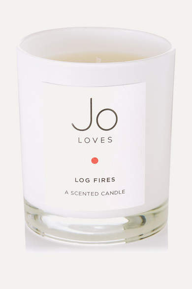 Jo Loves' candles are inspired by special memories and moments in life. Hand-poured in England, this style is a comforting blend of smooth, smoky woods laced with Lapsang Souchong Tea to evoke the scent of a roaring log fire.