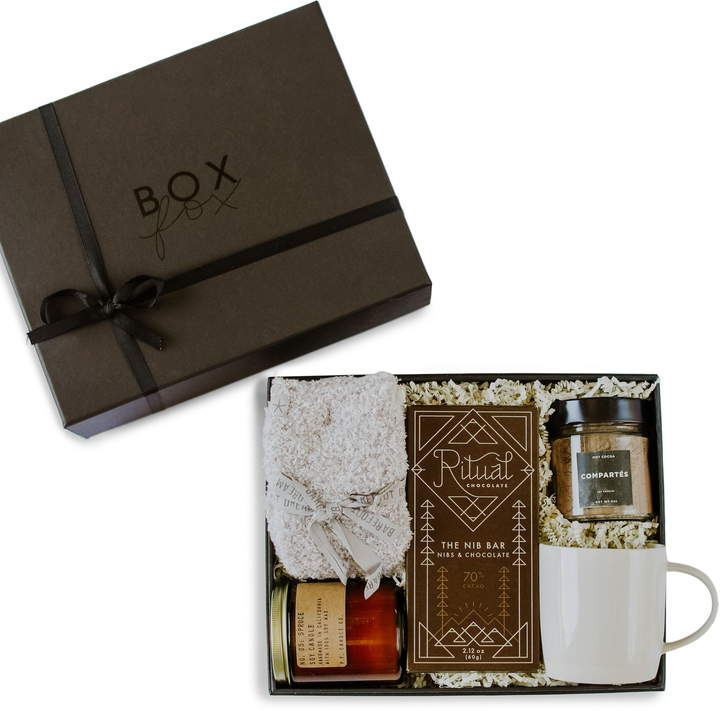From hot chocolate to sweet treats to cozy socks, this thoughtfully curated gift box includes all the must-haves for a hearthside evening