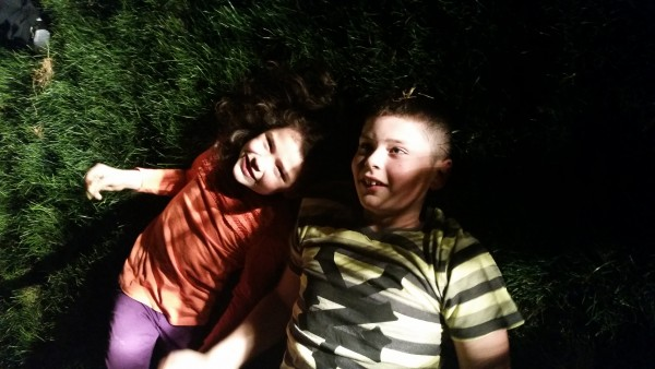 Brother and sister, laying in the grass and staring at the stars.