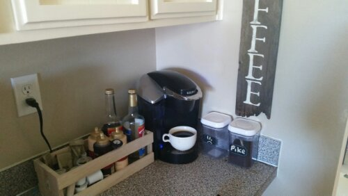 My coffee station.  It's actually a bit bare.  I'm missing a few syrups and on half a tank of Starbucks grinds.  Notice the Coffee sign? I've joked about adding marquee lights to act kind of like a light house when I'm straggling to it in the morning.
