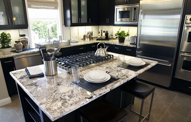granite kitchen countertops pictures canisters cream the stone cobblers cabinets and ma