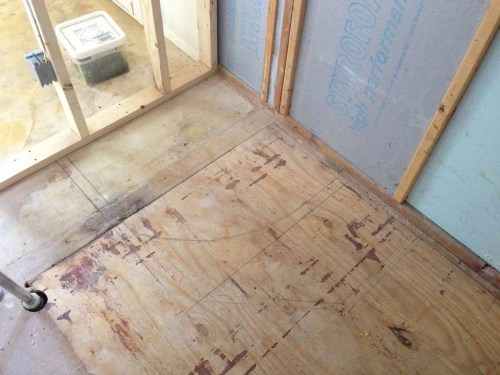 mapping-out-apartment bathroom-on-the-floor-
