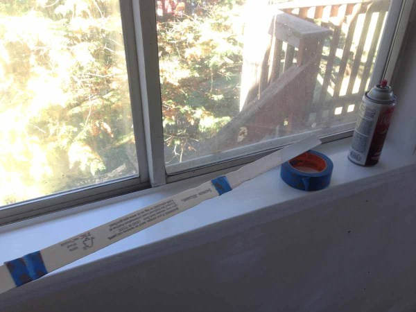 paint-stirrers-taped-together