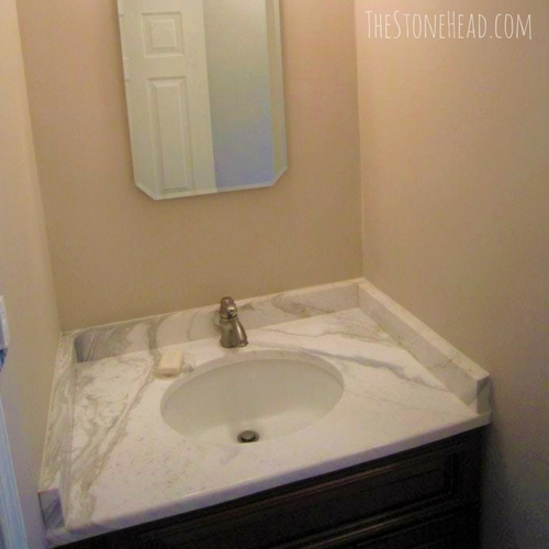 We're flipping houses for a living! Check out this marble vanity top we put in the bathroom remodel! Check out all the before and after pictures on my blog!