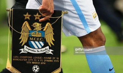 Captain Vincent Kompany of Manchester City carries a pennant prior to the UEFA Champions League round of 16 second leg match between Manchester City FC and FC Dynamo Kyiv at the Etihad Stadium on March 15, 2016 in Manchester, United Kingdom.