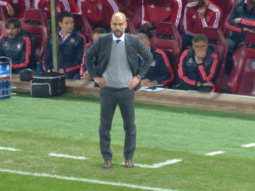 Pep Guardiola looks displeased as he watches his side during the Champions League match between Atletico Madrid and Bayern Munich, April 28, 2016. Photo by Sierra Godfrey.