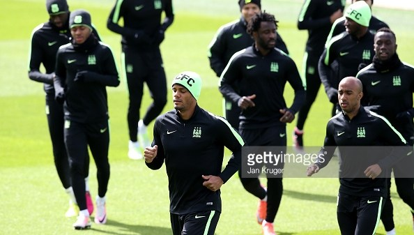 MANCHESTER, ENGLAND - MAY 03: Vincent Kompany of Manchester City (c) warms up with his team mates during a training session ahead of the UEFA Champions League Semi Final Second Leg match between Real Madrid and Manchester City at the Academy Training Ground on May 3, 2016 in Manchester, England. (Photo by Jan Kruger/Getty Images)