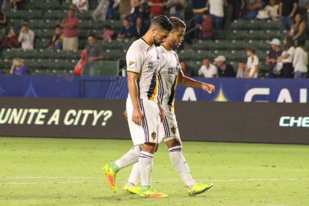 Gio dos Santos and Sebastian Lletget walk off after LA Galaxy's 2-1 loss to FC Dallas in the U.S. Open Cup semifinals