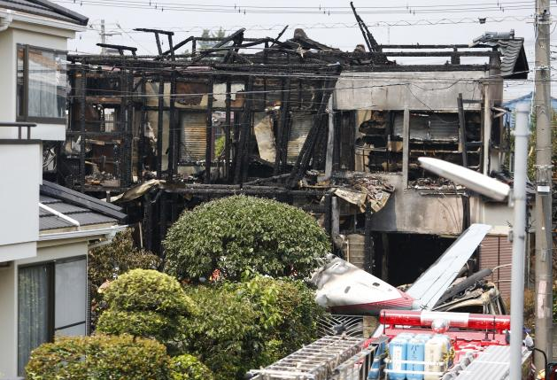 Little Plane Crashes in Tokyo, Setting Homes On fire