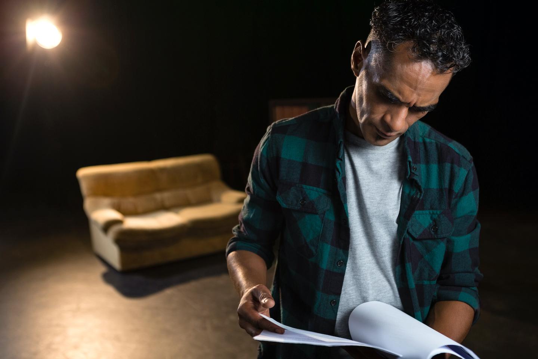 man reads scripts