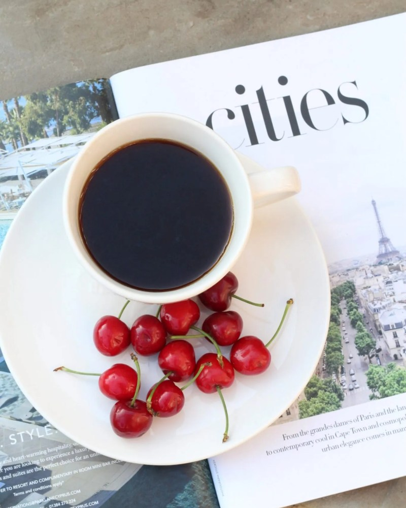 a cup of coffee with cherries and a magazine for blog on dating an insecure person in relationship
