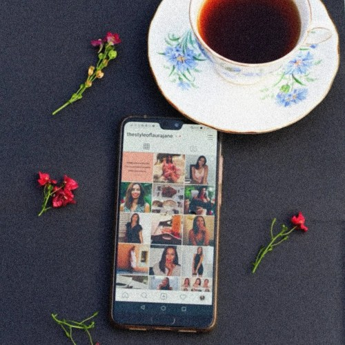 Image of Instagram on phone with coffee for blog on how guys use Instagram
