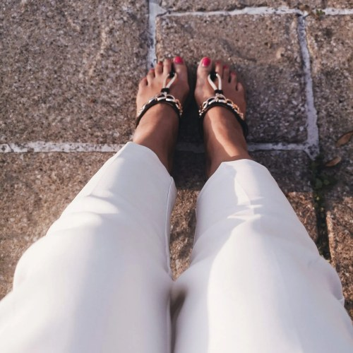 image of white trousers and sandals on women for blog post on addiction to male attention