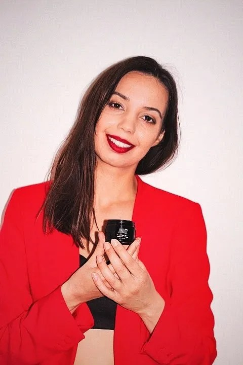 Image of girl holding neck cream for blog on IMIM Neck cream review - The Style of Laura Jane