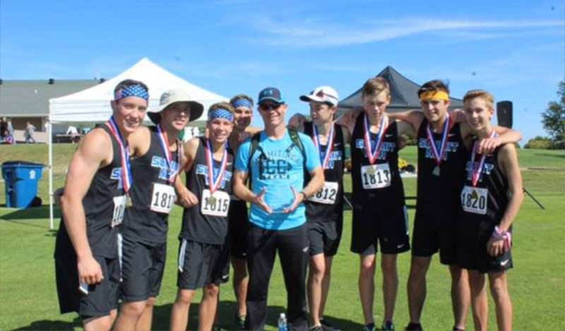 The Summit Prep boys Cross Country team poses for a team picture with their medals and awards.