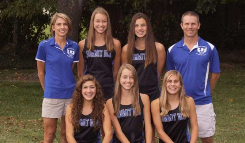 A team picture of The Summit girls Cross Country team with their two coaches.
