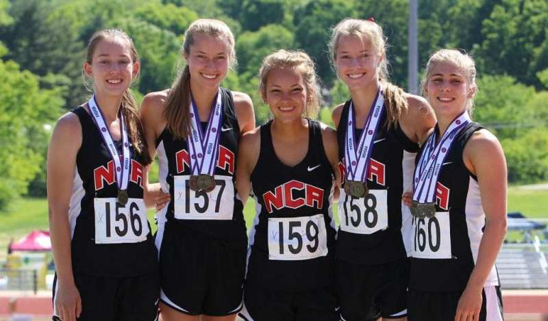 The Summit girls Track and Field team poses with their medals after a meet.