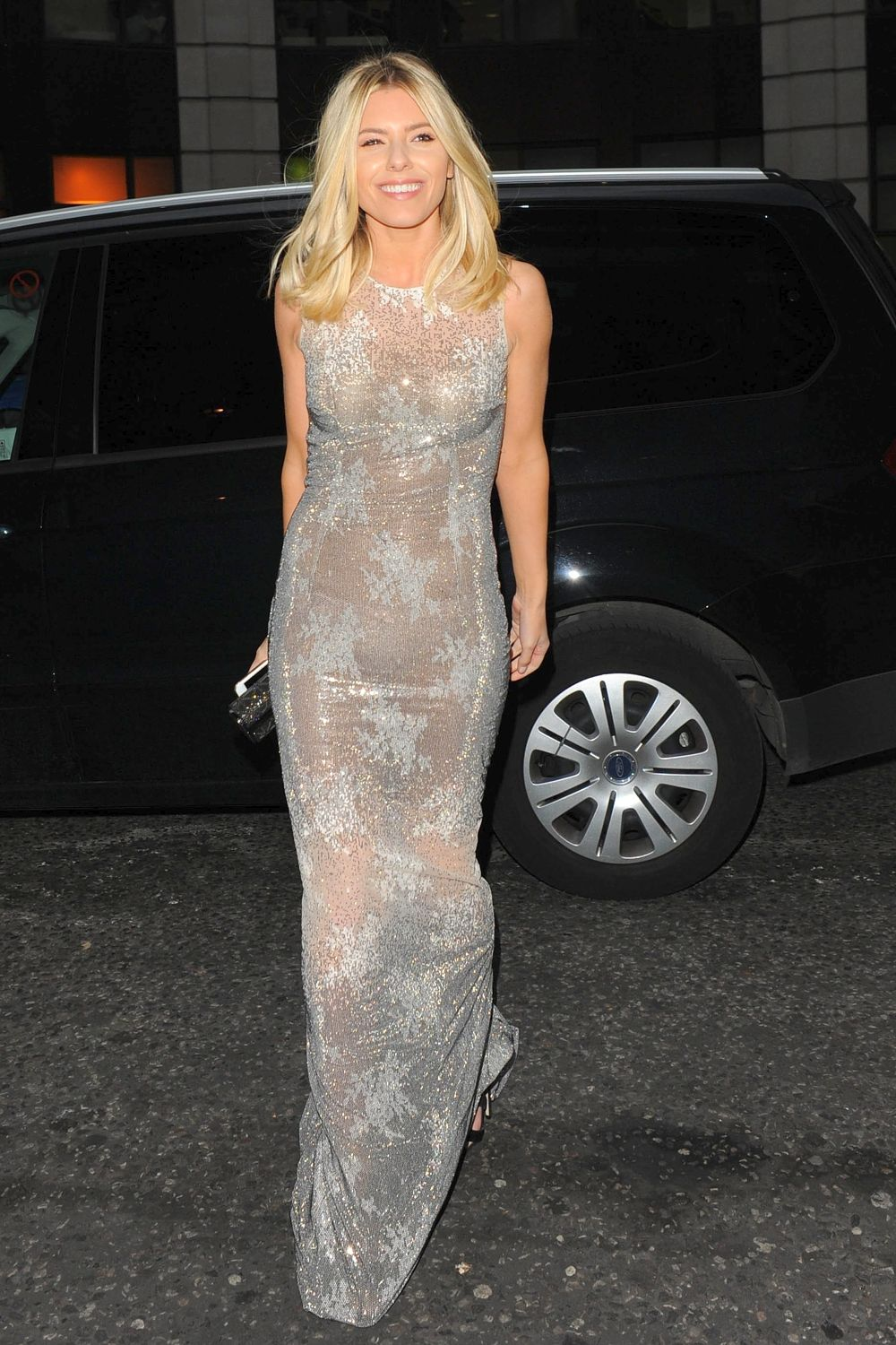 Mollie King Shimmers In Skin-tight Silver Gown Sun