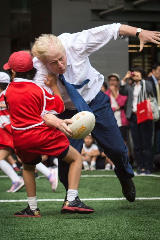 The pair collide as the London Mayor heads for the try line