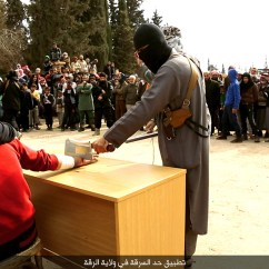 Make Up Chair Office Kl Sickening Moment Isis Savages Brutally Execute Syrian Prisoner Using A Massive Three-foot ...