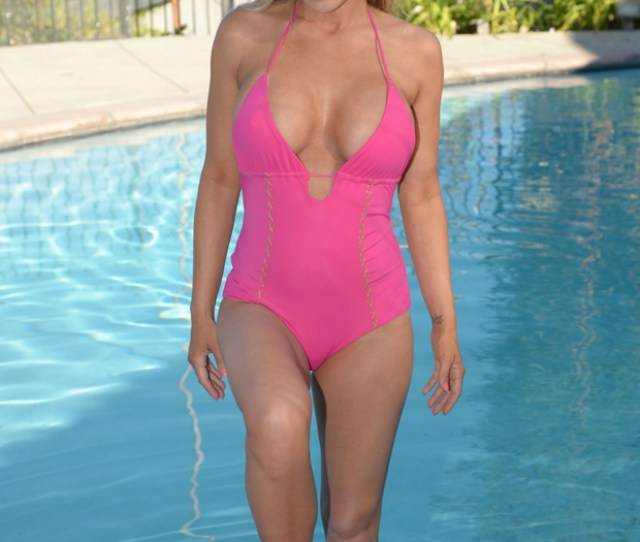 Carmen Electra Looks Pink Credible As She Busts Out Of Sexy