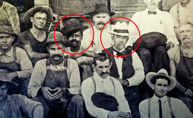 A photo shows Jack Daniel with a moustache and to his right is believed to be a son of Nearis Green - the slave who helped teach Daniel how to make whiskey