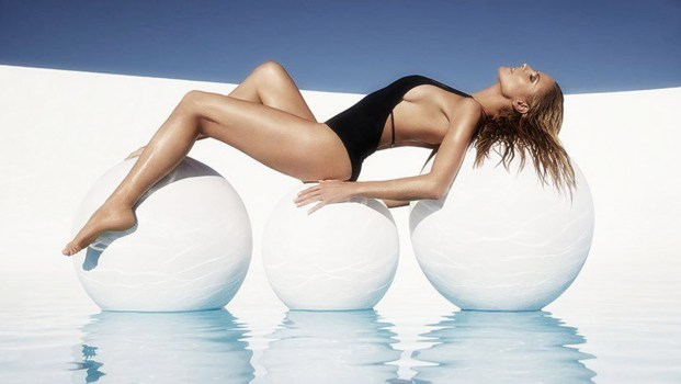 She lay back and chilled out as she showed off a racy black one-piece with a scoop neckline