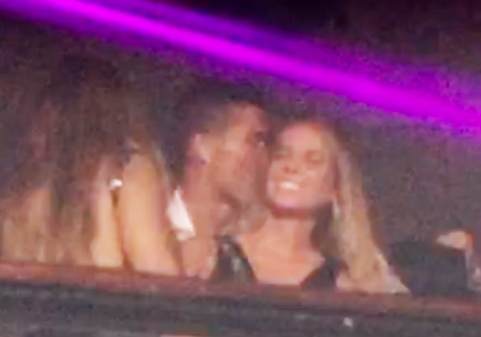Cristiano Ronaldo pictured kissing a mystery blonde in an Ibiza club