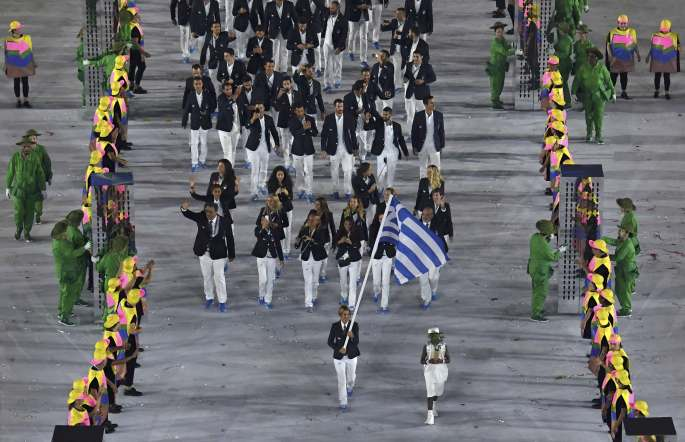 In keeping with tradition, Greece were the first country to march into the stadium