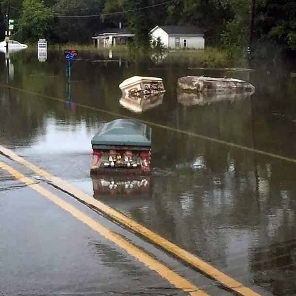 Eerie caskets float down the street near sate capital Baton Rouge