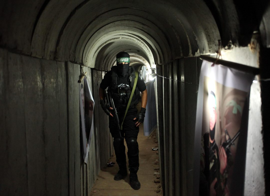 A member of Hamas stands inside one of the terror tunnels linking the Gaza Strip and Israel