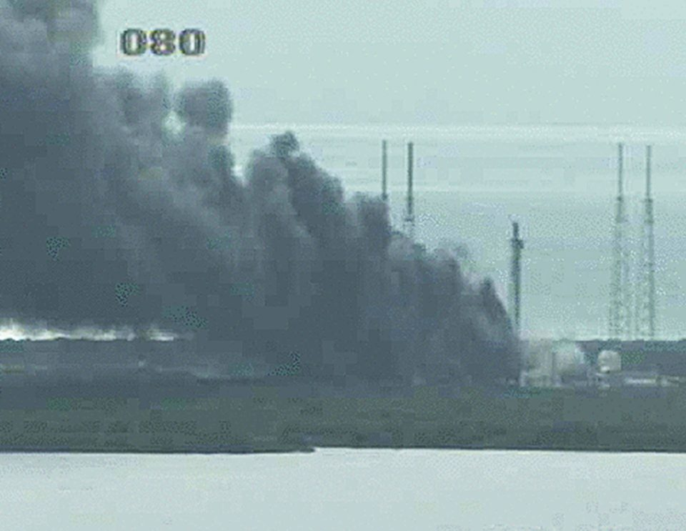 An image from the NASA live camera shows a fire raging on the launch pad at Cape Canaveral