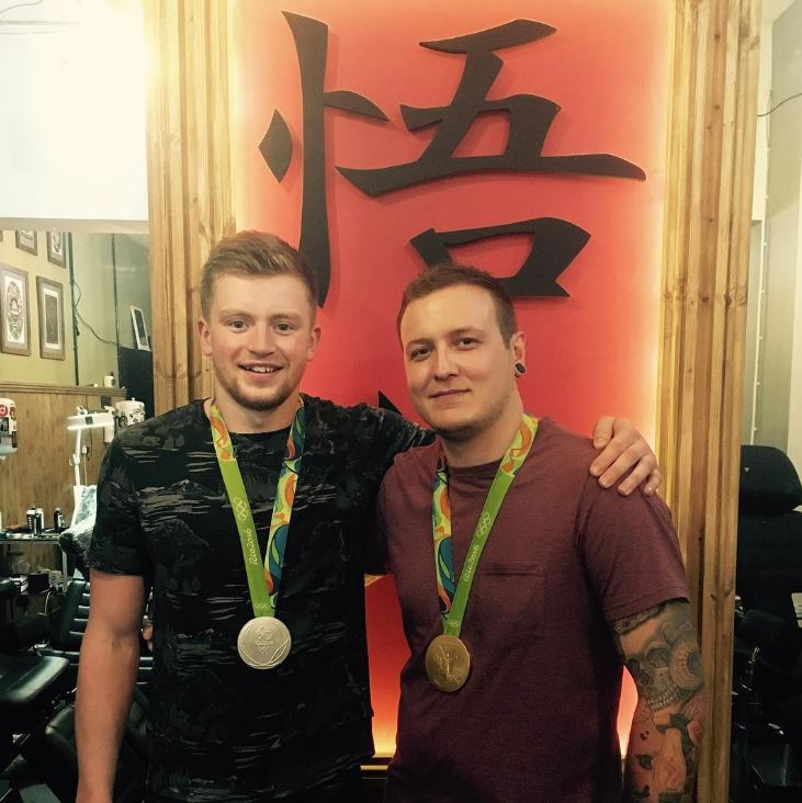 The Olympic gold medalistwith tattoo artist Andy Radford