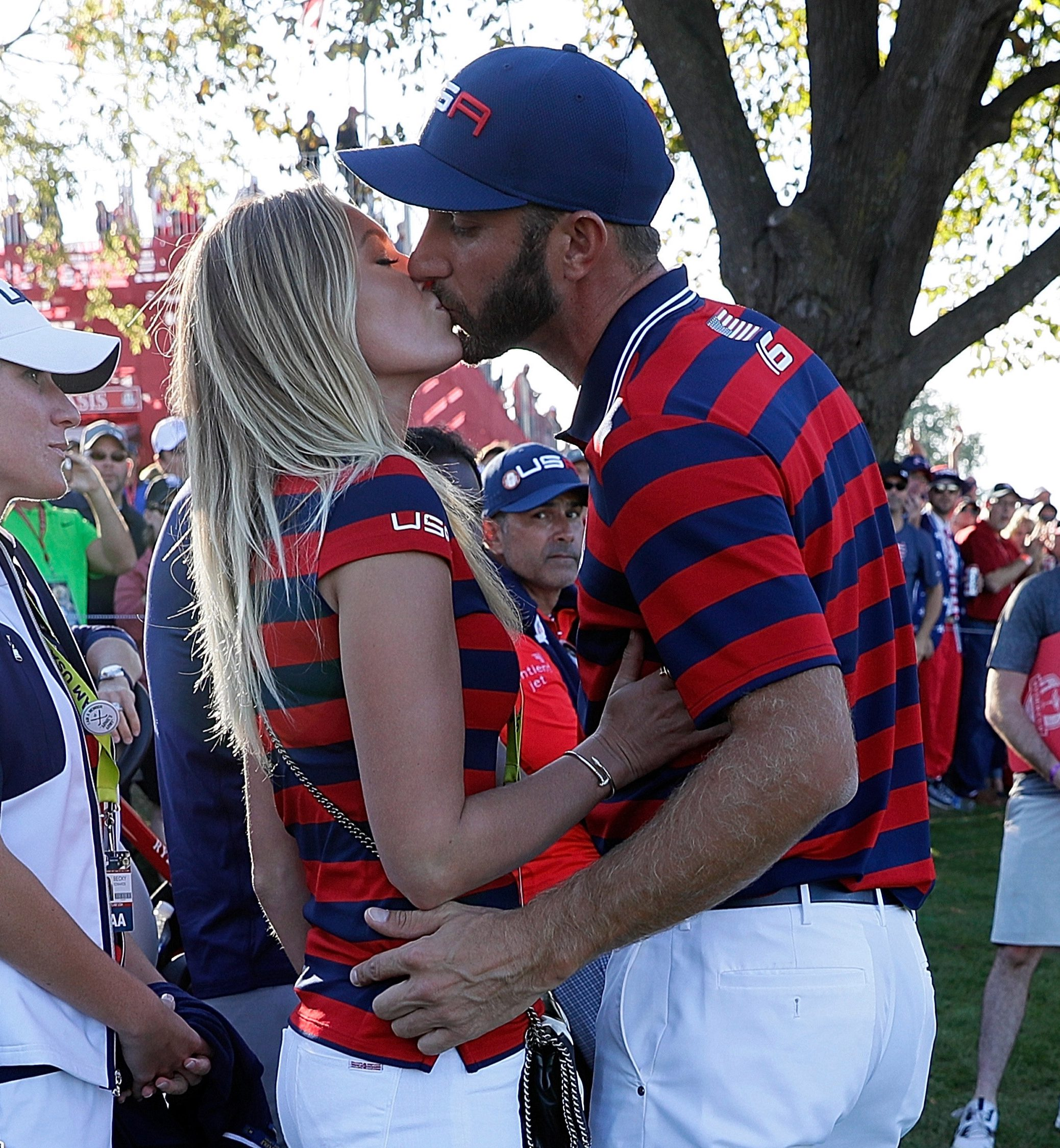 Paulina Gretzky kisses fiance Dustin Johnson for good luck during the Ryder Cup last year