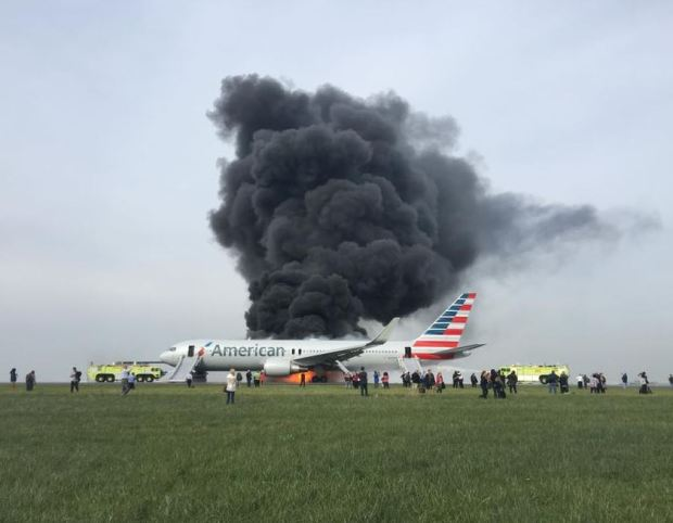 Image result for Passenger plane evacuated as it catches fire at Chicago airport