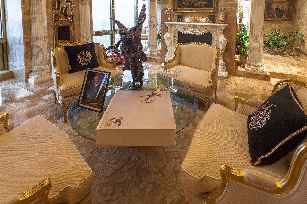 A bronze statue of Eros and Psyche, one of the great Greek love stories, flanks a picture of his father on the glass coffee table in this sitting room, while Barron's toy Mercedes is parked by the window. Athenian Greek vases are also displayed on top of the grand marble fireplace while a rare signed copy of a Muhammad Ali tribute book worth £12,000 ($15,000) takes pride of place on the table top