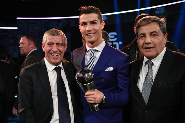 The Real Madrd multiple trophy winner stands alongside Portugal's Euro 2016 winning coach Fernando Santos