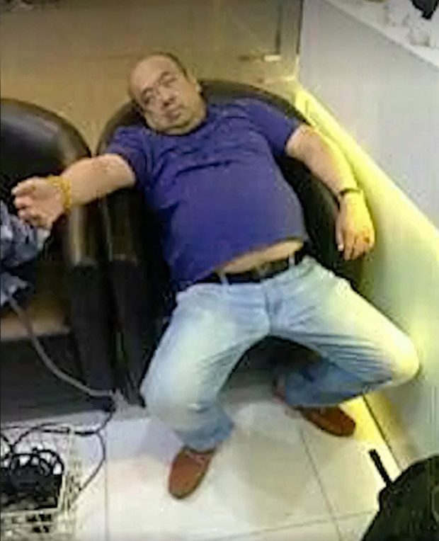 Kim Jong-un's brother Kim Jong-nam is seen slumped in an airport chair after apparently being poisoned by assassins