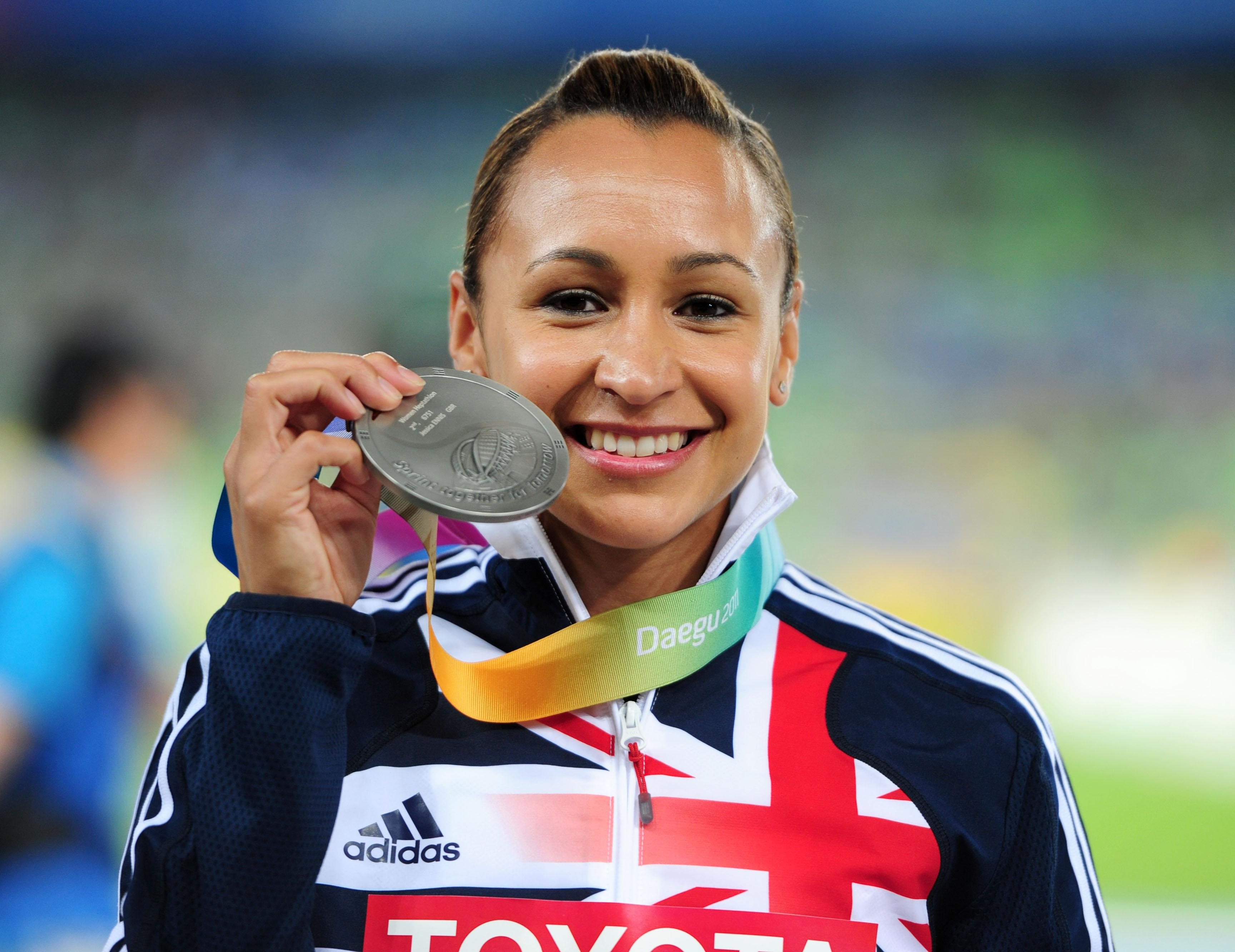 The Sheffield star holding aloft her silver medal she won in the heptathlon at the 2016 Olympic Games