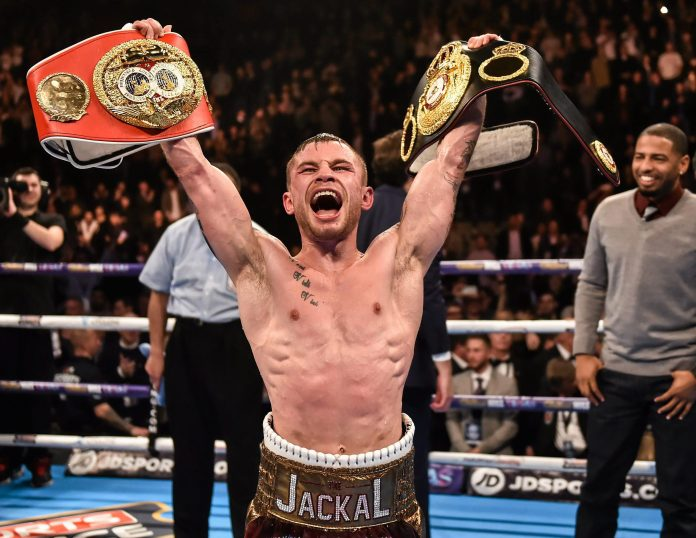 Carl Frampton celebrates with the IBF and WBA Super-Bantamweight belts after defeating Scott Quigg