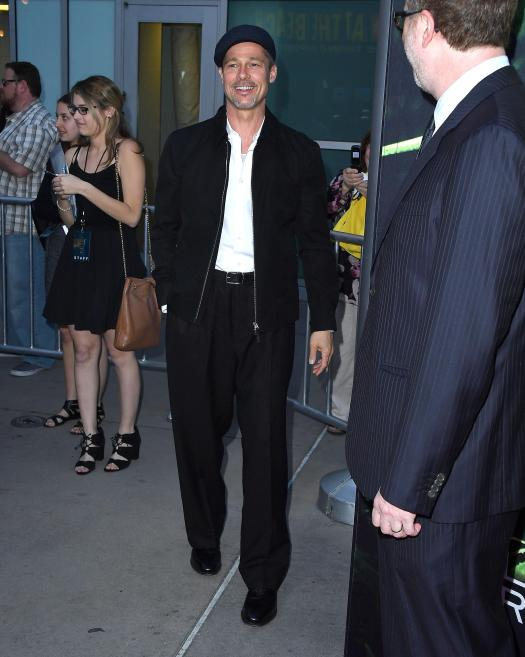 The actor wore baggy black trousers which had been cinched in by a belt