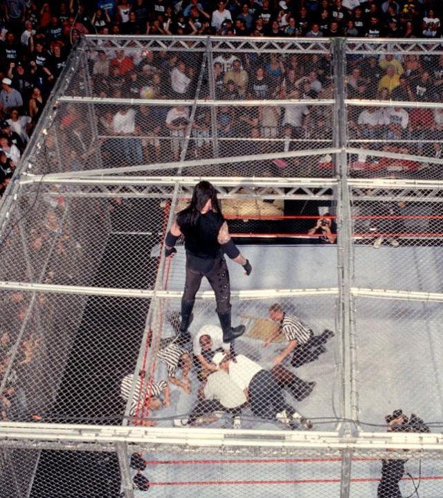 The Undertaker looks down on Mankind in their famous match in 1998