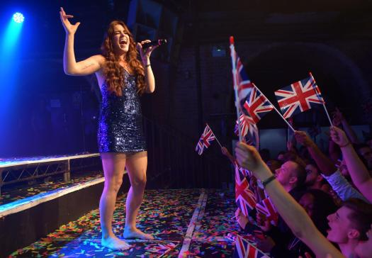 Lucie performs in front of flag waving revellers