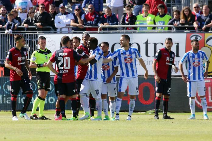 Players from both sides get into a scuffle as Sulley Muntari prepares to leave