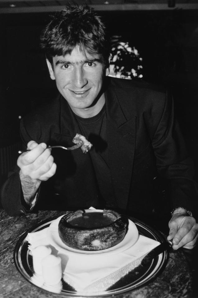 Eric Cantona tucks into a Yorkshire pudding while playing at Leeds in 1992