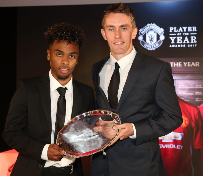 Phil Neville gives Angel Gomes his young player of the year award