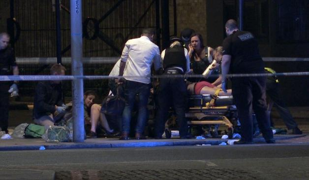 A victim is pictured being treated on a stretcher following the terror attack on London Bridge