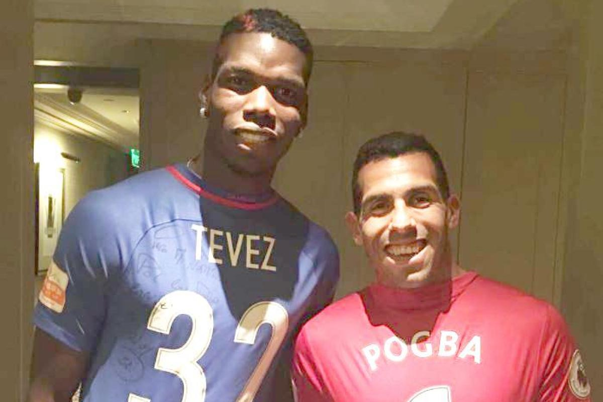 67393ef1c41 Paul Pogba meets up with former Juventus team-mate Carlos Tevez as he  continues his tour of China