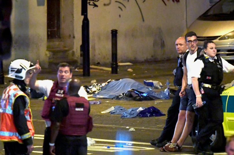 A body lies covered in the street after the van attack in North London