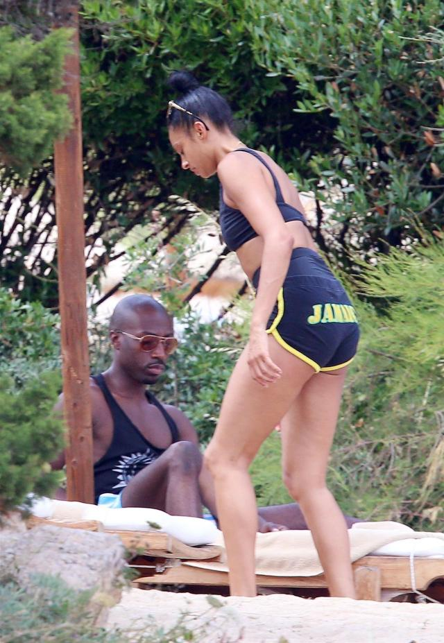 BEACH BABE Alesha Dixon shows off her toned abs as she strips down to a bikini